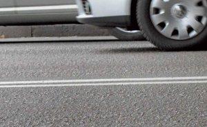 В Олимпийской столице начали наносить на дороги специальную разметку